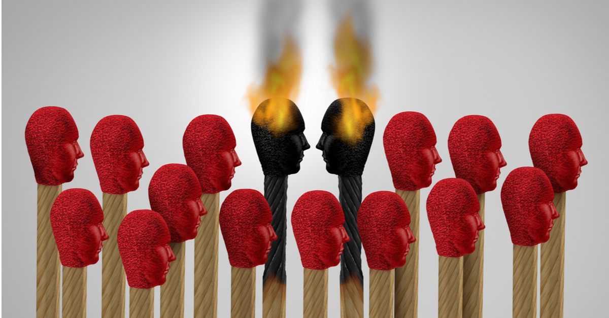 Picture of multiple match heads and two in the middle have ignited